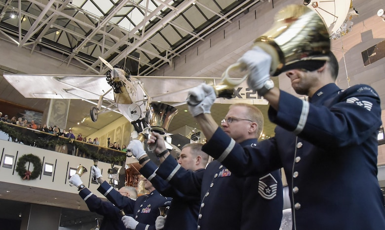 U.S. Air Force Band members play handbells during the band's annual holiday flash mob performance at the Smithsonian National Air and Space Museum in Washington, D.C., Nov. 29, 2016. (U.S. Air Force photo by Jim Varhegyi)(released)