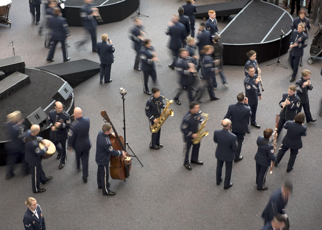 U.S. Air Force Band Commander Col. Larry H. Lang conducts the band's annual holiday flash mob performance at the Smithsonian National Air and Space Museum in Washington, D.C., Nov. 29, 2016. (U.S. Air Force by Airman Gabrielle Spalding)(released)