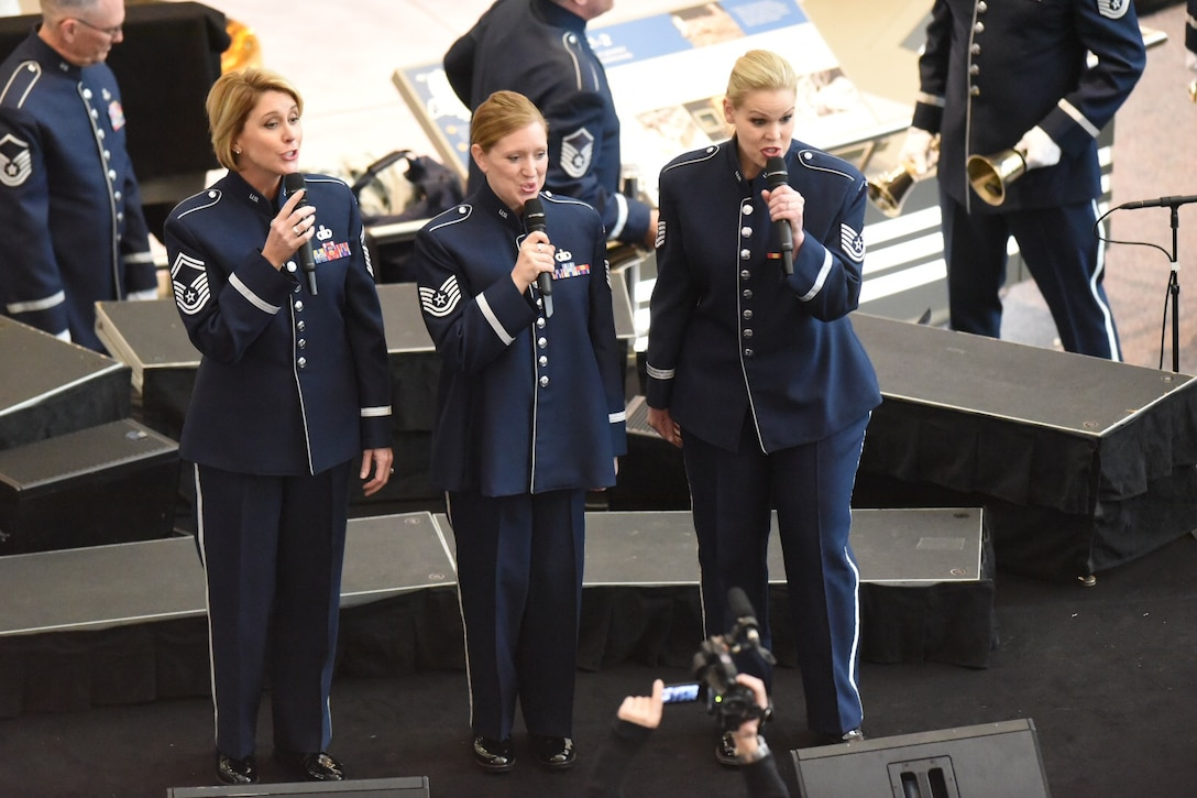 U.S. Air Force Band Commander Col. Larry H. Lang conducts the band's annual holiday flash mob performance at the Smithsonian National Air and Space Museum in Washington, D.C., Nov. 29, 2016. (U.S. Navy photo by JBAB/PA)