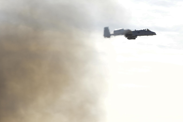 An A-10C Thunderbolt II flies past a fire after completing operational testing at Davis-Monthan Air Force base, Ariz., Nov. 28, 2016.  The Air National Guard Air Force Reserve Command Test Center, A-10 Combined Test Force performed the testing to collect A-10 sensor performance data in the presence of a large fire. (U.S. Air Force photo by Senior Airman Betty R. Chevalier)
