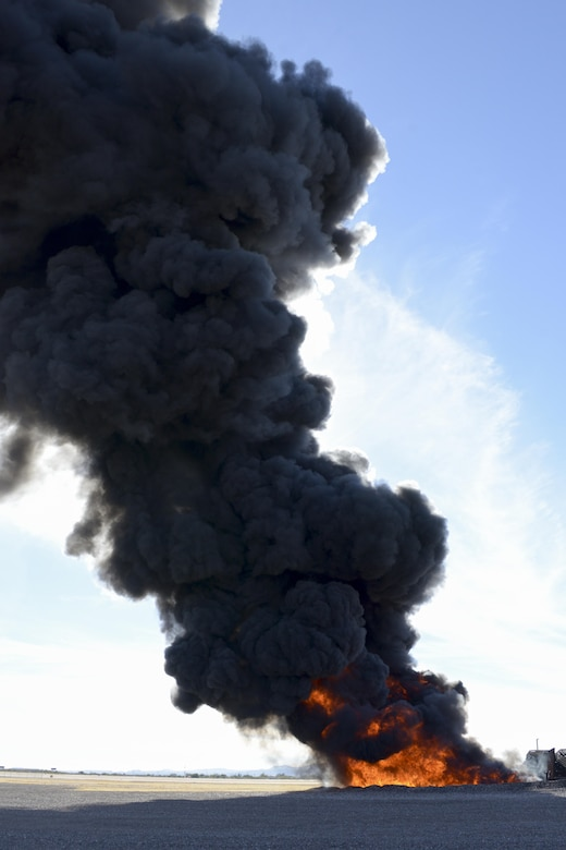 A large fire produces black smoke on the fire training grounds at Davis-Monthan Air Force Base, Ariz., Nov. 28, 2016. The D-M Fire Department allowed the fire to burn longer to simulate conditions pilots may encounter during combat operations, which allowed the Air National Guard Air Force Reserve Command Test Center, A-10 Combined Test Force to conduct operational testing. (U.S. Air Force photo by Senior Airman Betty R. Chevalier)