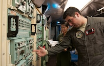 First Lt. Allia Martinez, 320th Missile Squadron missile combat crew commander and 2nd Lt. Benjamin Lenos, 320th MS deputy combat crew commander perform checks on the strategic automated command and control system in a launch control center at F.E. Warren Air Force Base, Wyo., Nov. 6, 2016. The 90th Missile Wing sustains 150 Minuteman III ICBMs and the associated launch facilities that cover 9,600 square miles across three states. (U.S. Air Force photo by Staff Sgt. Christopher Ruano)