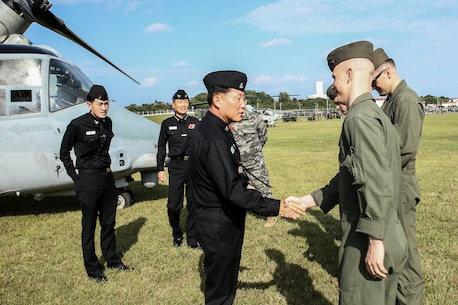 Republic of Korea Rear Admiral Jong Sam Kim shakes Marines' hands after a capabilities demontration on Camp Hansen, Okinawa, Japan, Nov.30, 2016. The Marines were with 31st Marine Expeditionary Unit. 31st MEU Marines continue to participate in events with their ROK counterparts to strengthen interoperability and partnerships. (U.S. Marine Corps. photo by Lance Cpl. Jorge A. Rosales/released)
