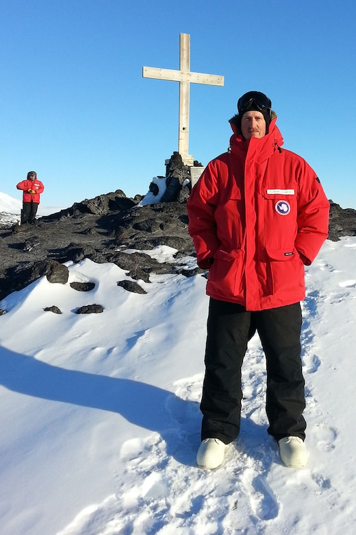 U.S. Air Force Lt. Col. Brian Bohlman, chaplain assigned to the 169th Fighter Wing, poses in front of a cross at McMurdo Station in Antarctica, Oct. 23, 2016. (Courtesy photo of the National Science Foundation )