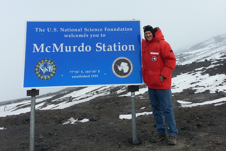 U.S. Air Force Lt. Col. Brian Bohlman, chaplain assigned to the 169th Fighter Wing, poses in front of the McMurdo Station sign in Antarctica, Oct. 22, 2016. (Courtesy photo of the National Science Foundation)