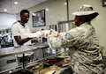 Airman 1st Class Shanette Whitehead, 379th Expeditionary Force Support Squadron service journeyman, serves a member food during the lunch meal in the Independence Dining Facility Sept. 20, 2016, at Al Udeid Air Base, Qatar. The dining facilities serve more than 500,000 meals per month, and they are supported by both contractors and EFSS personnel. (U.S. Air Force photo/Senior Airman Janelle Patiño/Released)