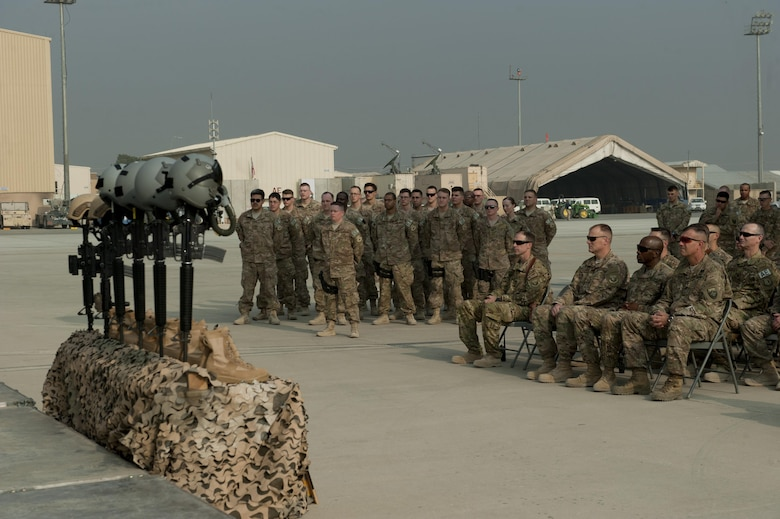 Airmen from the 455th Expeditionary Security Forces Squadron gather in a formation during the TORQE 62 remembrance ceremony, Bagram Airfield, Afghanistan, Oct. 2, 2016. Two Fly Away Security Team Airmen were lost when Torque 62 crashed during takeoff at Jalalabad Airfield, Afghanistan on Oct. 2, 2015. (U.S. Air Force photo by Capt. Korey Fratini)