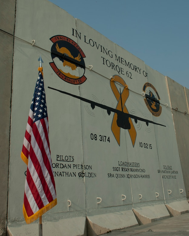 A mural on the flightline honors those Airmen who lost their lives when TORQE 62 crashed one year ago, Bagram Airfield, Afghanistan, Oct. 2, 2016. A ceremony was held to honor and remember Capt. Jordan Pierson, Capt. Jonathan Golden, Staff Sgt. Ryan Hammond, Senior Airman Quinn Johnson-Harris, Senior Airman Nathan Sartain, and Airman 1st Class Kcey Ruiz who were lost on Oct. 2, 2015. (U.S. Air Force photo by Capt. Korey Fratini)