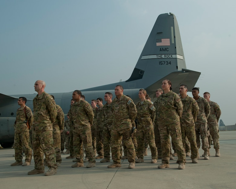 Airmen from the 774th Expeditionary Airlift Squadron and the 455th Expeditionary Aeromedical Evacuation Squadron gather in a formation during the TORQE 62 remembrance ceremony, Bagram Airfield, Afghanistan, Oct. 2, 2016. Six Airmen were lost on Oct. 2, 2015 when TORQE 62, a C-130J Super Hercules, crashed during takeoff. (U.S. Air Force photo by Capt. Korey Fratini)