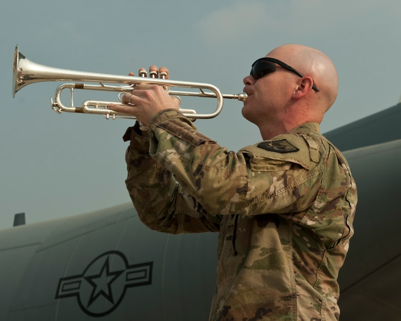 A bugle player with the U.S. Forces Afghanistan Band plays taps during the TORQE 62 remembrance ceremony, Bagram Airfield, Afghanistan, Oct. 2, 2016. The ceremony was held to honor and remember those lost when TORQE 62 crashed on Oct. 2, 2015. (U.S. Air Force photo by Capt. Korey Fratini)