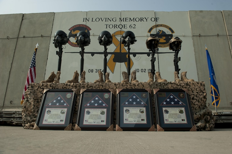 Battlefield crosses representing the six Airmen lost during a C-130J crash, are placed in front of a mural in memory of TORQE 62, Bagram Airfield, Afghanistan, Oct. 2, 2016. A ceremony was held to remember and honor the live lost when TORQE 62 crash during takeoff at Jalalabad Airfield, Afghanistan, Oct. 2, 2015. (U.S. Air Force photo by Capt. Korey Fratini)
