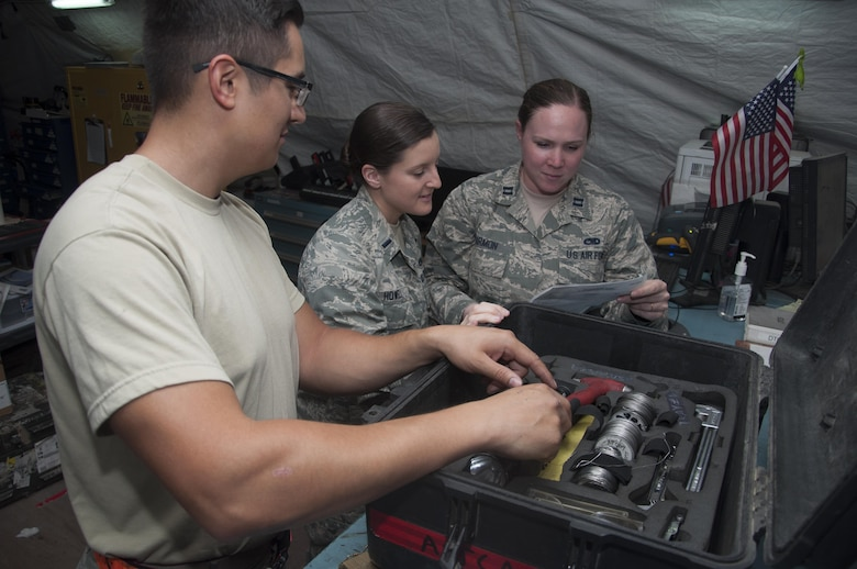 Staff Sgt. Bradley Chaplin, 1st Lt. Erin Howell and Capt. Katherine Harmon from the 5th Expeditionary Air Mobility Squadron inspect a tool kit that is used for maintenance Sept. 29, 2016 at an undisclosed location in Southwest Asia. They support the maintainers by ensuring that equipment and parts are available to get the mission accomplished.(U.S. Air Force photo by Master Sgt. Anika Jones/Released)