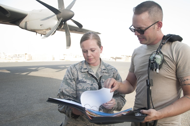 1st Lt. Solveig Listerud goes through a checklist with Staff Sgt. Justin Wise both from the 386th Expeditionary Aircraft Maintenance Squadron Sept. 27, 2016 at an undisclosed location in Southwest Asia. The overall readiness hinges on quality assurance for successful operation of the C-130 Hercules fleet.(U.S. Air Force photo by Master Sgt. Anika Jones/Released)