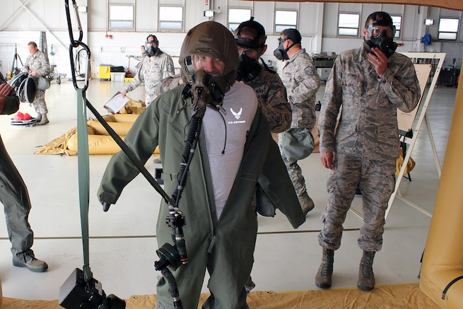 Capt. Brett Devries, a pilot with the 107th Fighter Squadron, removes his chemical warfare protective garb during a training exercise at Selfridge Air National Guard Base, Mich., Oct. 2, 2016. Airmen with the Michigan Air National Guard conduct a wide variety of training simulations on an annual basis to allow them to be ready to continue to operate in challenging environments. (U.S. Air National Guard photo by Tech. Sgt. Dan Heaton)