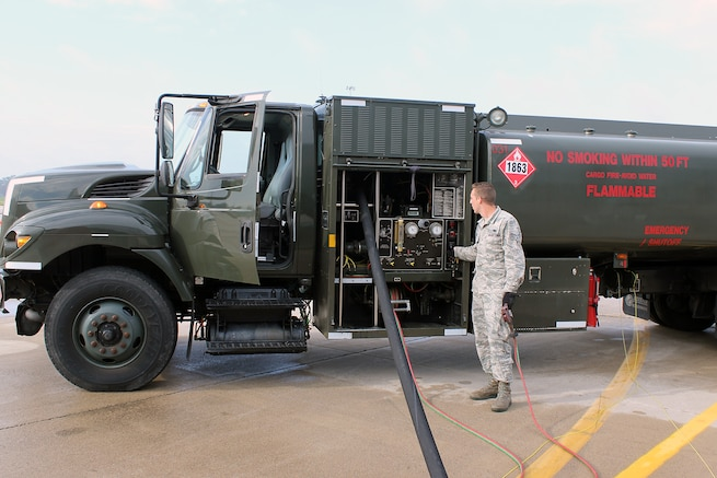 Senior Airman Dalton Sweet, a fuels specialist with the 127th Logistics Readiness Squadron, monitors the operation of a refueling truck while refueling a KC-135 Stratotanker at Selfridge Air National Guard Base, Oct. 2, 2016. . Sweet is a member of the Michigan Air National Guard and is assigned to Selfridge. (U.S. Air National Guard photo by Tech. Sgt. Dan Heaton)