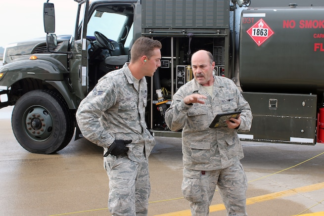 Senior Airman Dalton Sweet, a fuels specialist with the 127th Logistics Readiness Squadron, and Master Sgt. Mike Kerr, a crew chief with the 191st Maintenance Squadron, conduct a safety briefing before beginning refueling operations on a KC-135 Stratotanker at Selfridge Air National Guard Base, Oct. 2, 2016. Both Airmen are members of the Michigan Air National Guard and are assigned to Selfridge. (U.S. Air National Guard photo by Tech. Sgt. Dan Heaton)