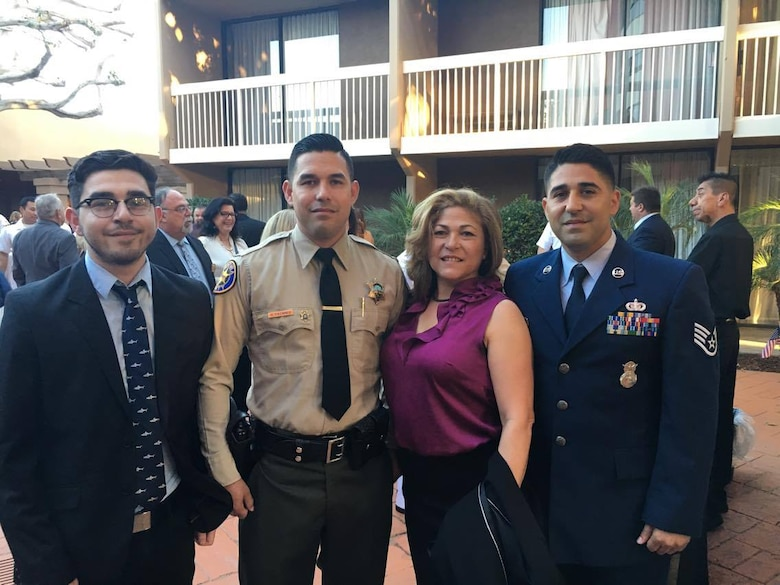 Staff Sgt. Jesus Cazares, 146th Airlift Wing unit training manager, and service members from other services were recognized at the Oxnard Chamber of Commerce Annual Military Appreciation Dinner, September 30. Cazares, who was born and raised in Oxnard shared this special moment with his mom, two brothers and fiancé. (Courtesy Photo)