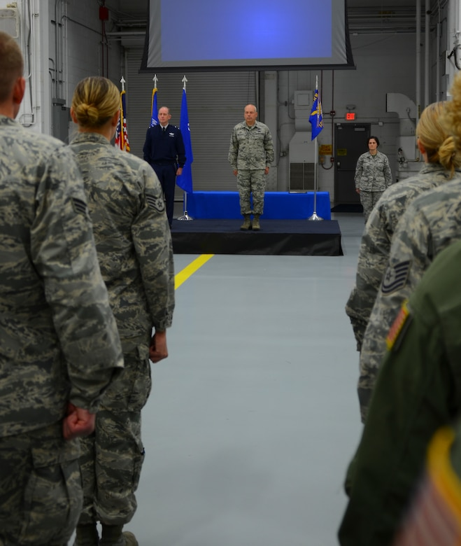 Standing in the ranks of the 128th Air Refueling Wing Air Force Outstanding Unit Award presentation ceremony, Airmen look on as Major General Donald P. Dunbar, Adjutant General of the Wisconsin National Guard, waits to present the unit award to Col. Daniel Yenchesky, commander of the 128 ARW in a formal ceremony Oct. 2, 2016 at General Mitchell Airfield, Milwaukee. This award marks the seventh time the 128 ARW has received the AFOUA and covers the period of Oct. 1, 2014 through Sept. 30, 2015.  (Air National Guard photo by Tech. Sgt. Meghan Skrepenski, 128 ARW Public Affairs/Released)