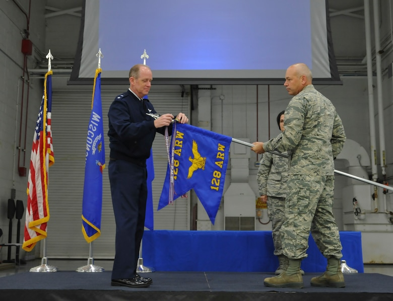 Major General Donald P. Dunbar, Adjutant General of the Wisconsin National Guard, presents the Air Force Outstanding Unit Award to Col. Daniel Yenchesky, commander of the 128th Air Refueling Wing in a formal ceremony Oct. 2, 2016 at General Mitchell Airfield, Milwaukee. This award marks the seventh time the 128 ARW has received the AFOUA and covers the period of Oct. 1, 2014 through Sept. 30, 2015. (Air National Guard photo by Senior Airman Morgan R. Lipinski, 128 ARW Public Affairs/Released)