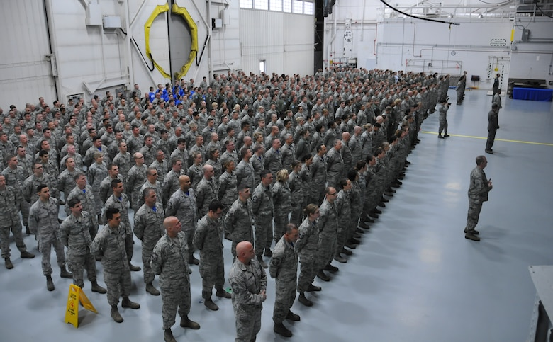 Airmen of the 128th Air Refueling Wing stand at attention as Major General Donald P. Dunbar, Adjutant General of the Wisconsin National Guard, presents the Air Force Outstanding Unit Award to Col. Daniel Yenchesky, commander of the 128 ARW in a formal ceremony Oct. 2, 2016 at General Mitchell Airfield, Milwaukee. This award marks the seventh time the 128 ARW has received the AFOUA and covers the period of Oct. 1, 2014 through Sept. 30, 2015.  (Air National Guard photo by Senior Airman Morgan R. Lipinski, 128 ARW Public Affairs/Released)