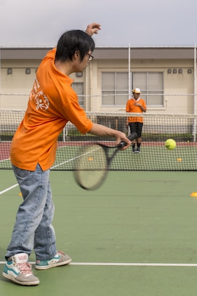 An athlete participates in a game of tennis during the Special Olympics Nippon Hiroshima at Marine Corps Air Station Iwakuni, Japan, Oct. 2, 2016. Activities held at the Special Olympics included basketball, futsal, tennis, bowling and a duathlon. This program provides year-round training for upcoming competitions in a variety of Olympic-style sports, and it is catered to children and adults with mental and learning disabilities. As the 10th Special Olympics Hiroshima held at the air station, event coordinators hope to publicize the event and encourage more athletes to compete. (U.S. Marine Corps photo by Lance Cpl. Aaron Henson)