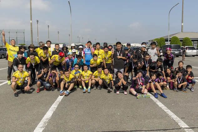 Athletes pose for a group photo after finishing a duathlon during the Special Olympics Nippon Hiroshima at Marine Corps Air Station Iwakuni, Japan, Oct. 2, 2016. Activities held at the Special Olympics included basketball, futsal, tennis, bowling and a duathlon. The Special Olympics instills confidence, inspires a sense of competition and improves health through the transformative power of sports. (U.S. Marine Corps photo by Lance Cpl. Aaron Henson)