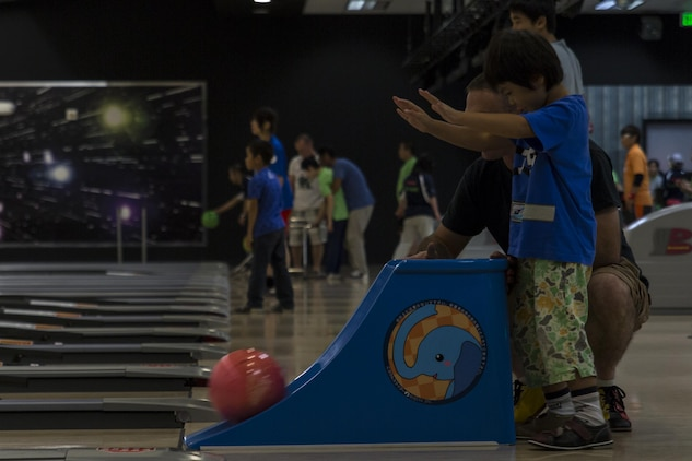 An athlete competes in a bowling competition during the Special Olympics Nippon Hiroshima at Marine Corps Air Station Iwakuni, Japan, Oct. 2, 2016. Activities held at the Special Olympics included basketball, futsal, tennis, bowling and a duathlon. The Special Olympics instills confidence, inspires a sense of competition and improves health through the transformative power of sports for children and adults with mental and learning disabilities. (U.S. Marine Corps photo by Lance Cpl. Aaron Henson)