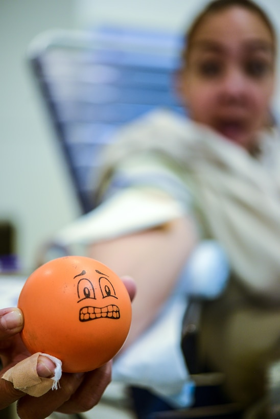 U.S. Air Force Staff Sgt. Deeanne Rosario, a Reservist air transportation journeyman with the 73rd Aerial Port Squadron, Fort Worth, Texas, holds a stress ball as she is prepares to donate blood during an Armed Services Blood Program-Europe blood drive at the Kaiserslautern Military Community Center, Sept. 20, 2016. The ASBP collected blood to be used by U.S. service members and their families. The majority of the blood collected is sent to deployed locations. (U.S. Air Force photo by Staff Sgt. Timothy Moore)