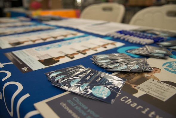 Pamphlets of charitable donation information rest on display during the Combined Federal Campaign 2016 kickoff at Osan Air Base, Republic of Korea, Oct. 3, 2016. Over a period of nine weeks, members of Team Osan have the chance to contribute to various charities. (U.S. Air Force photo by Senior Airman Dillian Bamman)