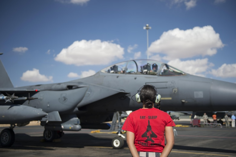 U.S. Air Force Airman 1st Class Alexis Rodriguez, 48th Air Craft Maintenance Squadron aircraft armament system technician, stands by to marshal out an F-15E Strike Eagle before a sortie in support of Tactical Leadership Programme 16-3 at Los Llanos Air Base, Spain Sept. 30. Throughout its 39-year history, TLP has become the focal point for NATO's Allied Air Forces tactical training, developing the knowledge and leadership skills necessary to face today's tactical challenges in the air. (U.S. Air Force photo/ Staff Sgt. Emerson Nuñez)