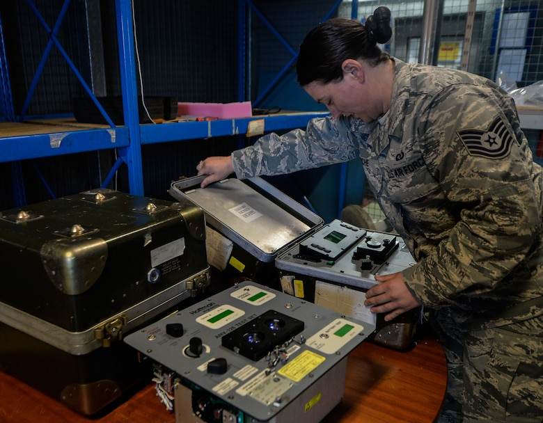 Tech Sgt. Haven Asche, 86th Operations Support Squadron air crew flight equipment NCO in charge, replaces an ANV126 night vision goggle tester for upgrades, Sept. 20, 2016 at Ramstein Air Base, Germany. AFE Airmen also test, inspect and maintenance radios, parachutes, life preserves, survival kits, flight helmets, oxygen masks and chemical gear for everyday and emergency situations. (U.S. Air Force photo/Senior Airman Nesha Humes)