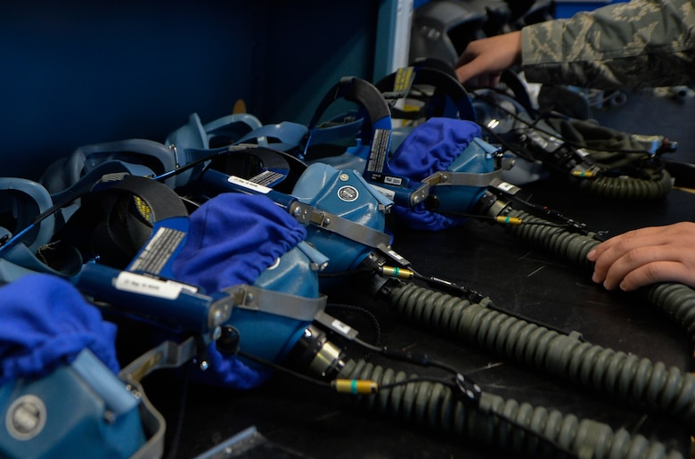 Tech Sgt. Haven Asche, 86th Operations Support Squadron air crew flight equipment NCO in charge, inspects a LL09 quick-don oxygen mask Sept. 20, 2016 at Ramstein Air Base, Germany. In addition to servicing flight equipment, AFEs instruct aircrew on its use and purpose. (U.S. Air Force photo/Senior Airman Nesha Humes)