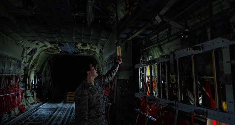 Tech Sgt. Haven Asche, 86th Operations Support Squadron aircrew flight equipment NCO in charge, checks equipment inventory onboard a C-130J Super Hercules Sept. 20, 2016 at Ramstein Air Base, Germany. The AFE flight mission is to ensure the safety of aircrew by properly equipping them for everyday and emergency missions. (U.S. Air Force photo/Senior Airman Nesha Humes)