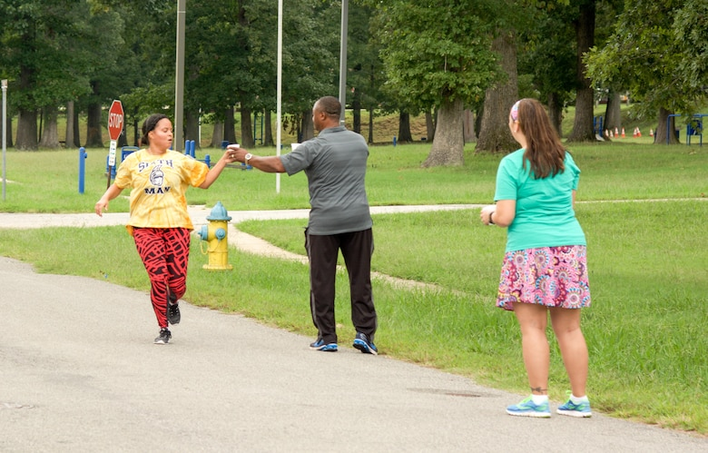 RICHMOND, Va. - 1st Lt. Kayla Duff, human resource manager for the 80th Training Command (TASS), grabs a sip of water as she completes her first lap of the Suicide Prevention Awareness 5K Fun Run/Walk at the Defense Supply Center held here on Sep. 28, 2016. The 80th TC held the event for all Department of Defense employees and their families. (Photo by Maj. Addie Randolph, 80th Training Command (TASS) Public Affairs)