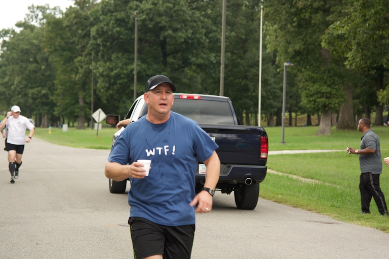 "RICHMOND, Va. - Sgt. 1st Class David Mangan, chaplain assistant at the 80th Training Command (TASS), rounds his first lap of the Suicide Prevention Awareness 5K Fun Run/Walk at the Defense Supply Center held here on Sep. 28, 2016.  Hoping to get a few laughs, his shirt logo ""WTF!"" reads on the back ""Where's The Finish?"" (Photo by Maj. Addie Randolph, 80th Training Command (TASS) Public Affairs)"