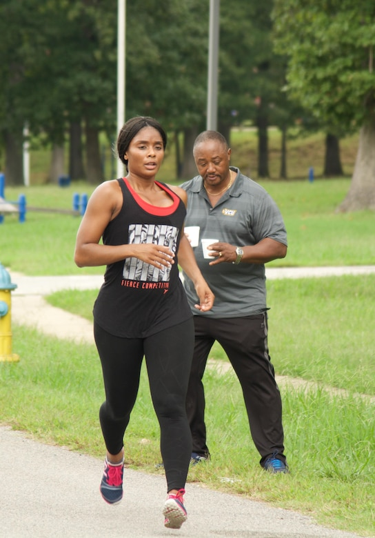RICHMOND, Va. - Staff Sgt. Son-Joi Brantley, executive administrative non-commissioned officer at the 80th Training Command (TASS), stays focused as she completes her first lap of the Suicide Prevention Awareness 5K Fun Run/Walk at the Defense Supply Center held here on Sep. 28, 2016. Suicide Prevention Program Manager for the 80th TC Dr. Alvin Moore stands in the background with cups of water to hand out to participants. The 80th TC held the event for all Department of Defense employees and their families. (Photo by Maj. Addie Randolph, 80th Training Command (TASS) Public Affairs)