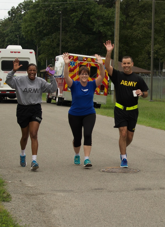 RICHMOND, Va. - (Left to right) Lt. Col. Julie Grant, human resources officer for the 80th Training Command (TASS), Mrs. Shelly Randall, and Maj. Thomas Randall, deputy staff judge advocate for the 80th TC, motivate each other as they race toward the finish line of the Suicide Prevention Awareness 5K Fun Run/Walk at the Defense Supply Center held here on Sep. 28, 2016. The 80th TC held the event for all Department of Defense employees and their families. (Photo by Maj. Addie Randolph, 80th Training Command (TASS) Public Affairs)