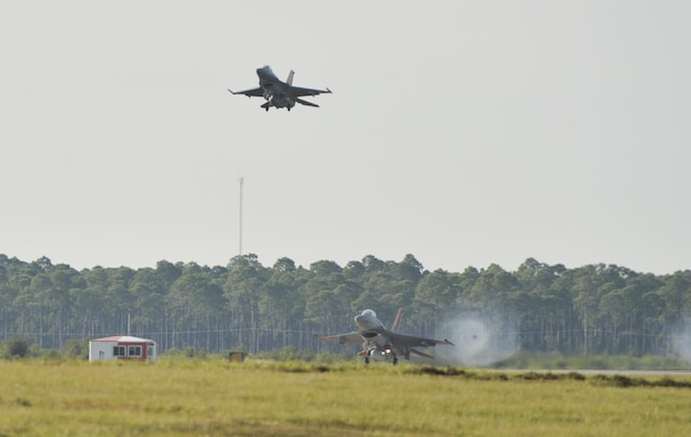 An unmanned QF-16 Full Scale Aerial Target from the 82nd Aerial Targets Squadron lands on an auxiliary runway at Tyndall Air Force Base, Fla., Sept. 29, 2016. The QF-16 is used by the 53rd Weapons Evaluation Group for unmanned aerial target training programs and data collection for the testing of weapon systems. (U.S. Air Force photo by Tech. Sgt. Javier Cruz/Released)
