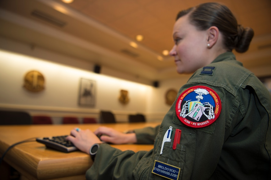 Capt. Victoria Fort, 90th Operational Support Squadron ICBM emergency war order planner, works at a computer station at F.E. Warren Air Force Base, Wyo., Sept. 20, 2016. Fort's specialty is ensuring the ICBM targeting coordinates are correct before information is sent to the field. (U.S. Air Force photo by Staff Sgt. Christopher Ruano)