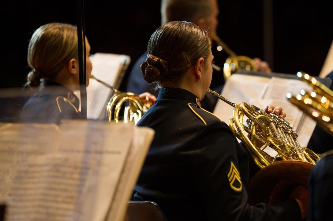 Army Staff Sgt. Selena Maytum, U.S. Army Field Band, plays at a concert.