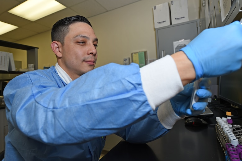 Senior Airman George Egan, 359th Clinical Laboratory and Radiology Flight medical lab technician, pipettes serum from a patient sample into a tube to be sent for advanced testing outside Joint Base San Antonio-Randolph, Texas, Sept. 16, 2016. While the 359th Medical Group can process routine samples, they partner with other JBSA labs, as well as local civilian labs, to conduct more specialized testing. (U.S. Air Force photo/Tech. Sgt. Christopher Carwile/Released)