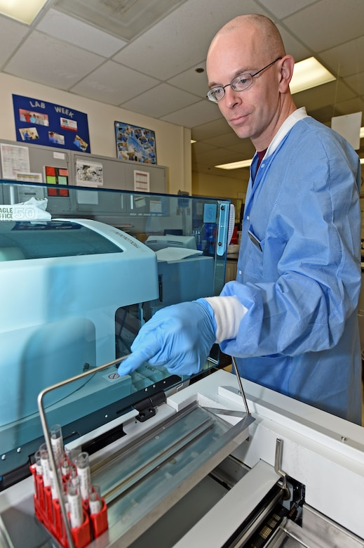 Staff Sgt. Kevin Arnett, 359th Clinical Laboratory and Radiology Flight medical lab technician, loads blood samples in a chemistry analyzer at the 359th Medical Group lab at Joint Base San Antonio-Randolph, Texas, Sept. 16, 2016. The analyzer checks that a patient's body and organs are functioning properly. (U.S. Air Force photo/Tech. Sgt. Christopher Carwile/Released).