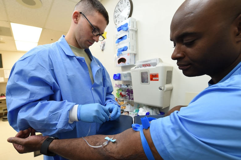 Staff Sgt. Donald Chapman, 359th Clinical Laboratory and Radiology Flight medical lab technician, draws a blood sample from a patient at the 359th Medical Group lab at Joint Base San Antonio-Randolph, Texas, Sept. 16, 2016. Regular blood samples, and those ordered by a primary care manager, ensure the health of all military members, dependents, and retirees. (U.S. Air Force photo/Tech. Sgt. Christopher Carwile/Released)