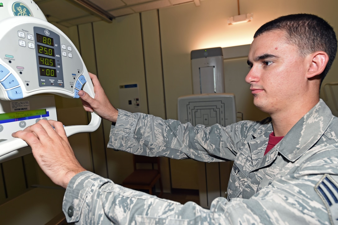 Senior Airman Taylor Clancy, a 359th Clinical Laboratory and Radiology flight radiology technician, adjust an X-ray machine to capture images needed for patient care at the 359th Medical Group on Joint Base San Antonio-Randolph, Texas, Sept. 16, 2016. Proper X-ray settings reduces necessary patient exposure to radiation and provides timely and accurate products to medical providers. (U.S. Air Force photo/Tech. Sgt. Christopher Carwile/Released)