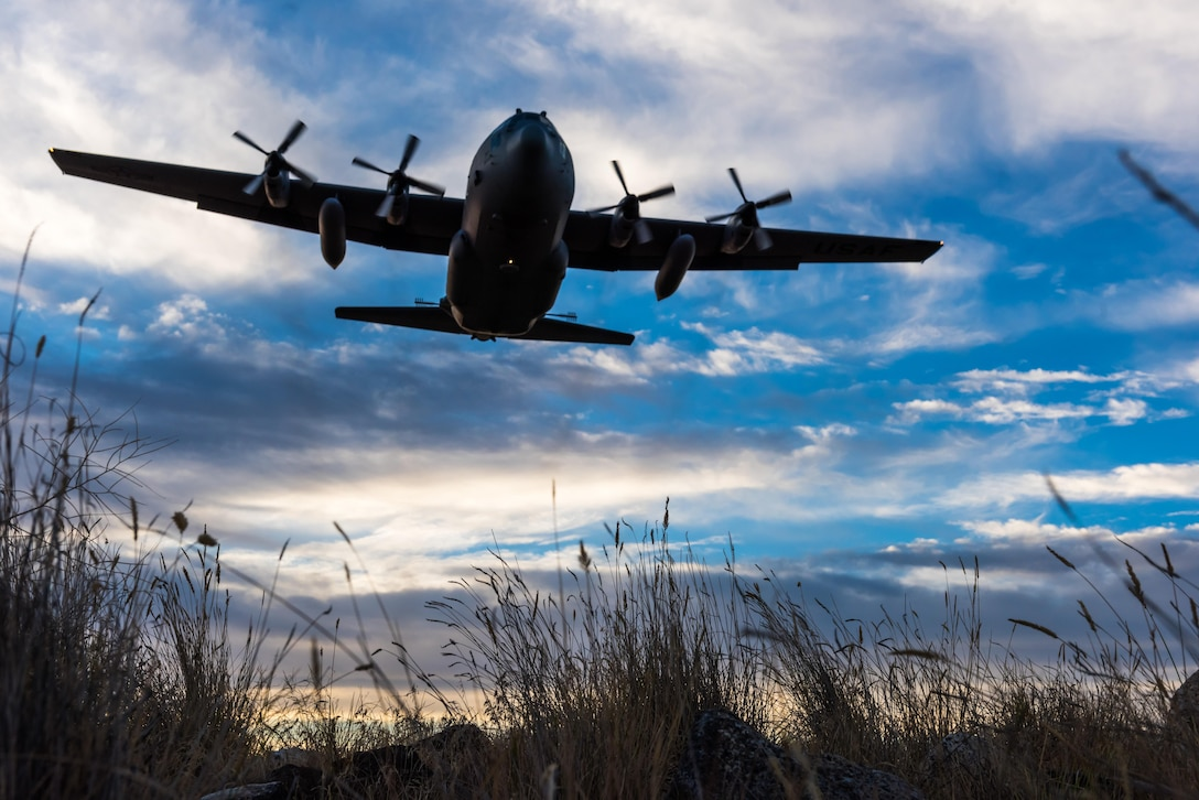 A modified C-130 Hercules soars overhead as it prepares to spray herbicide at the Saylor Creek Training Range, Idaho, Sept. 17, 2016. The aircraft, from the 910th Airlift Wing, flys only 100 feet above the ground to spray aerial herbicide. (U.S. Air Force photo by Senior Airman Connor J. Marth/Released)