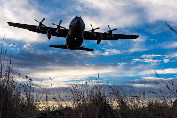 A modified C-130 Hercules soars overhead as it prepares to spray herbicide at the Saylor Creek