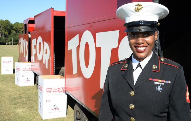 Cpl. Jasmine Alvarado, administrative clerk, Detachment 2, Combat Logistics Battalion-453, participates in the annual Toys for Tots campaign aboard Marine Corps Logistics Base Albany, Sept. 30.