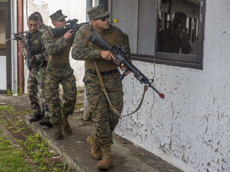 TARAVAO, Tahiti – U.S. Marine Lance Cpl. Jacob Richey, an administrative clerk with Headquarters Company, Task Forces Koa Moana 16-4, prepares to clear a room with French forces during urban operations training in Taravao, Tahiti, Sept. 23, 2016. American and French forces worked together to build partnership and learn from each other's tactics. (U.S. Marine Corps photo by Lance Cpl. Quavaungh Pointer)