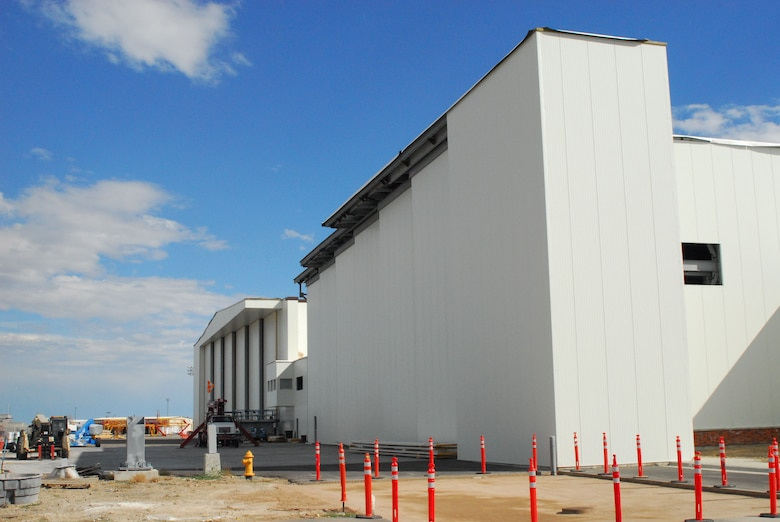 Construction on the 120th Airlift Wing's new corrosion control hanger, foreground, and the remodel of the unit's maintenance hangar is nearing completion. The hangar is scheduled to be completed in November, but the corrosion control hangar will not be completed until February 2017. (U.S. Air National Guard photo by Tech. Sgt. Michael Touchette)