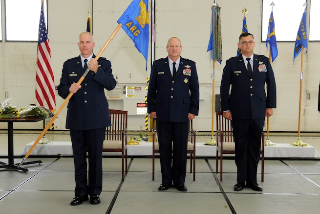 Col. Stanley Krasovic, 127th Air Refueling Group commander, holds the 127th ARG guidon during the change of command ceremony at Selfridge Air National Guard Base, Mich., on Oct. 1, 2016. Krasovic assumed command of the group replacing Col. David Brooks, who now serves as the 127th Wing vice commander. (U.S Air National Guard photo by Senior Airman Ryan Zeski)